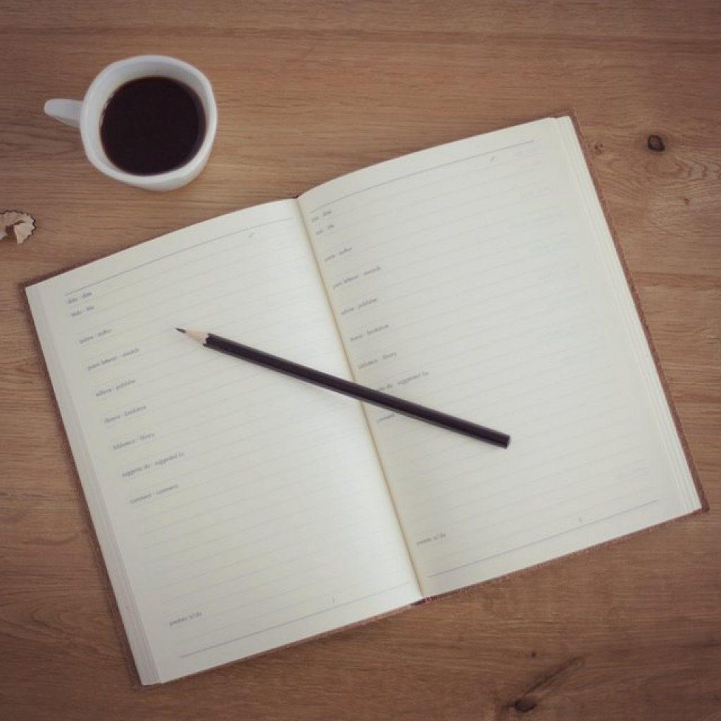 cuaderno agenda mesa cafe